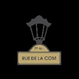 RUE DE LA COM.
